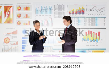 Businessman and businesswoman analyzing data information of market - stock photo