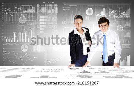 Businessman and businesswoman analyzing data information of market - stock photo
