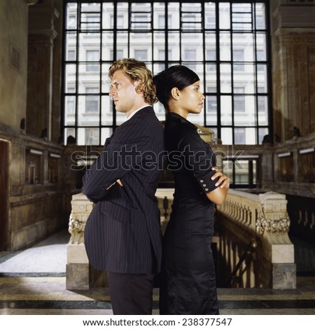 Businessman and Businesswoman Back to Back - stock photo