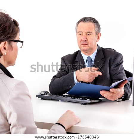 Businessman and businesswoman discuss business - stock photo