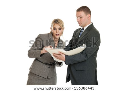 Businessman and businesswoman looking at documents in a folder isolated on a white background - stock photo
