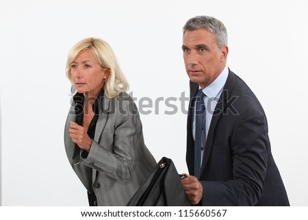 Businessman and businesswoman ready to race - stock photo