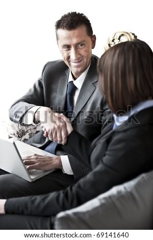 Businessman and Businesswoman shaking hands - stock photo