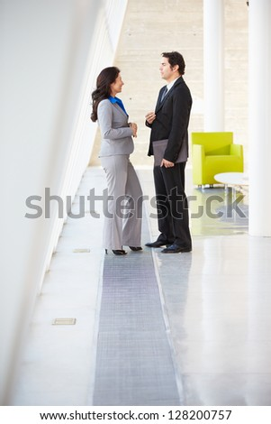 Businessman And Businesswomen Talking In Modern Office - stock photo