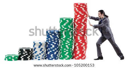 Businessman and casino chips on white - stock photo