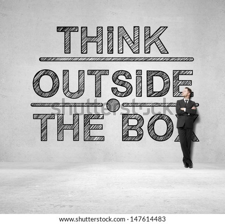 businessman  and drawing think outside the box - stock photo
