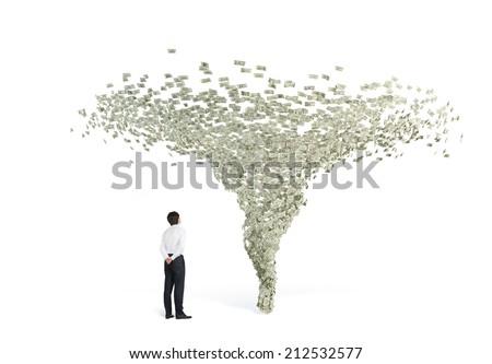 Businessman and Financial Tornado, A metaphor of power of money.  - stock photo