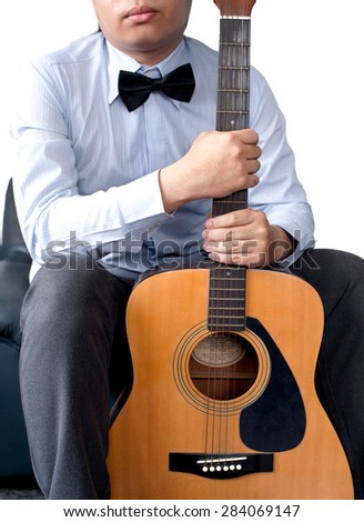 Businessman and his guitar - stock photo