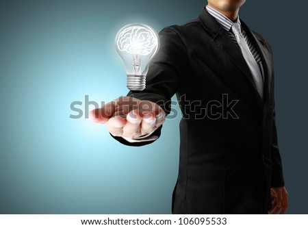 Businessman and Light bulb in a hand - stock photo