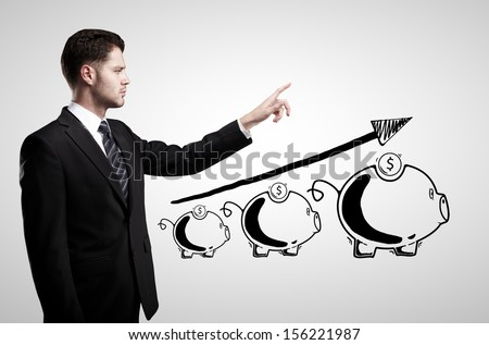 businessman and moneybox  on a white background - stock photo