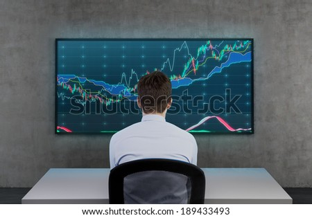 Businessman and observation of stock market. - stock photo