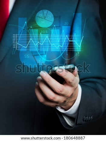Businessman and phone projection with graphs 4 - stock photo