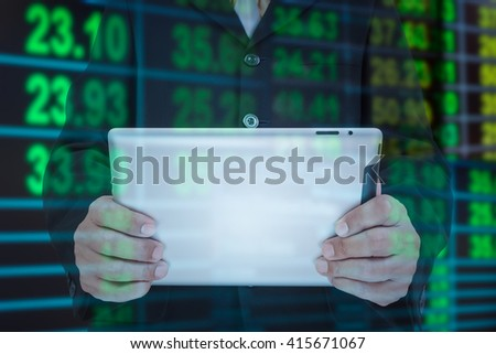 Businessman and smart phone in hand with exchange rate blur background - stock photo