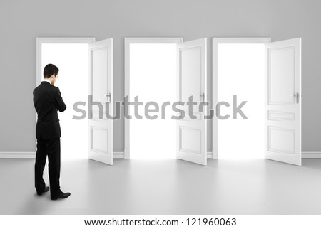businessman and three opened doors - stock photo