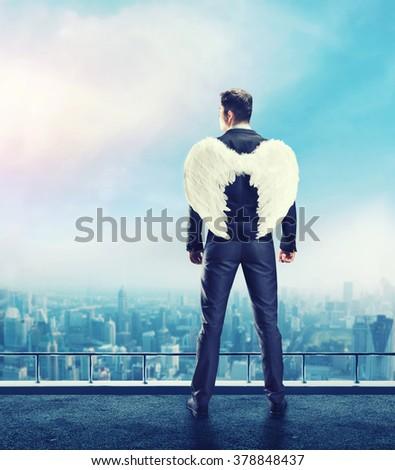 Businessman-angel - stock photo