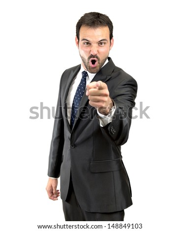 businessman angry and shouting over isolated white background - stock photo
