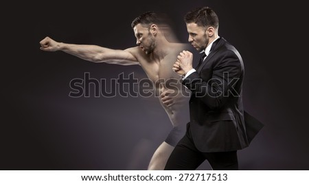Businessman as an athlete fighter - stock photo