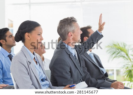 Businessman asking question during meeting in office - stock photo