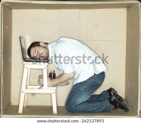 Businessman asleep at work - stock photo
