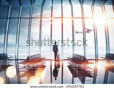 Businessman at airport near the window - stock photo