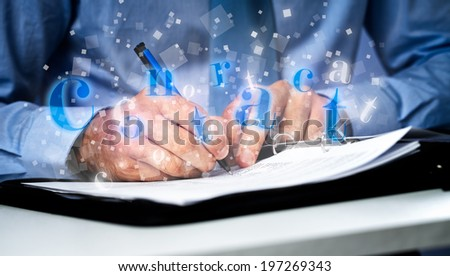 Businessman  at office desk signing a Business contract  - stock photo