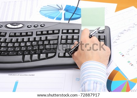 Businessman at office working at his workplace. - stock photo