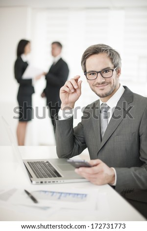 Businessman at phone in meeting - stock photo