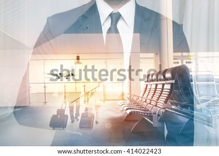 Businessman at the airport in double exposure. Man shows a hand sign okey at the airport terminal. - stock photo