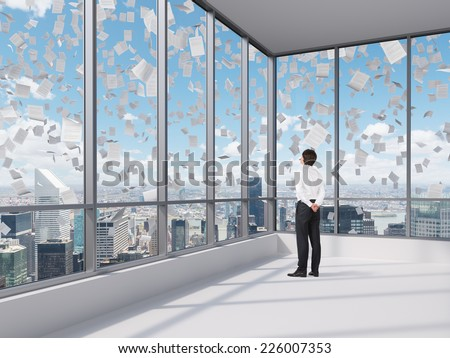 Businessman at the contemporary Manhattan office looking at the city. - stock photo