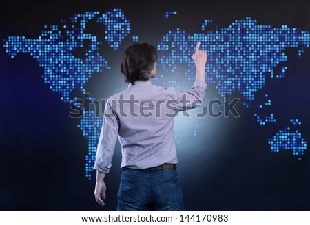 Businessman at the screen with a map. - stock photo