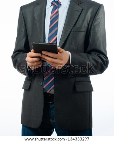 businessman at the table uses a digital tablet - stock photo