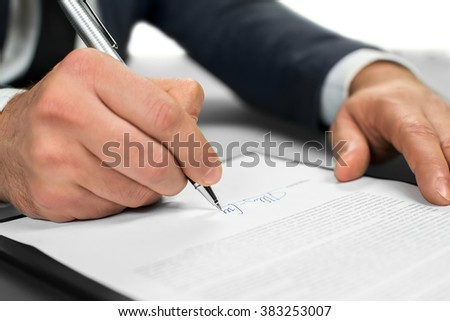 Businessman at work. Lawyer's paperwork. Read carefully. Making conclusions. - stock photo
