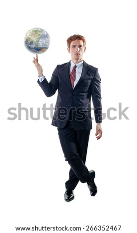 Businessman, balancing the globe on his forefinger. - stock photo