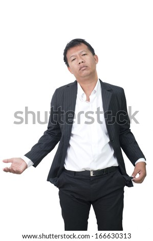 businessman bankrupt, his hands with two empty pockets - stock photo