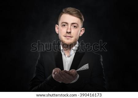Businessman beggar in suit over dark background. - stock photo