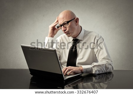 Businessman being in troubles - stock photo