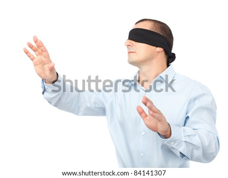Businessman blindfolded stretching his arms out, isolated on white background - stock photo