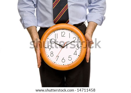 businessman body parts with a clock covering him - stock photo