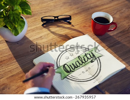 Businessman Brainstorming on a Concept About Quality - stock photo