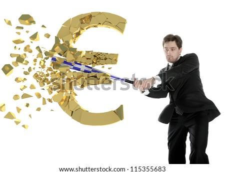 Businessman breaks the euro with a baseball bat. Shards flying toward. - stock photo