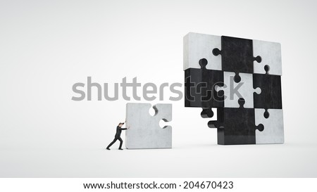 businessman building puzzle - stock photo