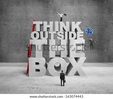 businessman building think outside the box - stock photo