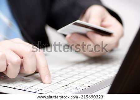 Businessman buys online. - stock photo