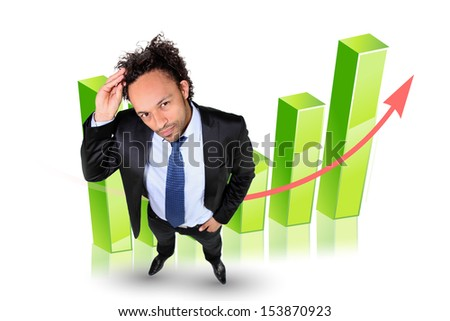 Businessman by a bar chart - stock photo