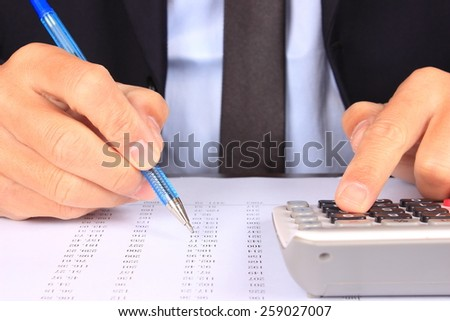 Businessman calculating bill - stock photo
