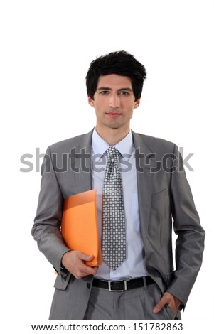 Businessman carrying a file - stock photo
