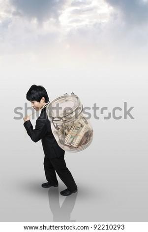 businessman carrying a money bag - stock photo