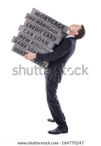 Businessman carrying debt - stock photo
