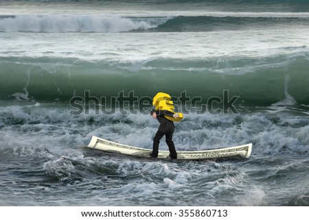 Businessman carrying golden euro sign on money boat in sea with wave coming. - stock photo