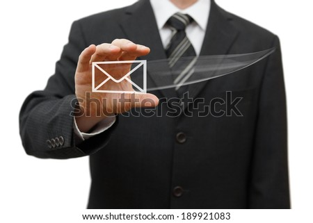 Businessman catching virtual email icon - stock photo